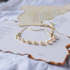 Dainty Gold Plated Link Chain Bracelet with Charms of Pearls and Shiny Rhinestone Leaf